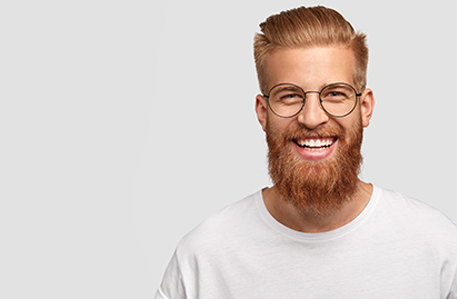 Happy male with long thick ginger beard
