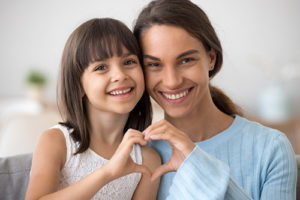 about lovett dental katy, mother and daughter making heart hands