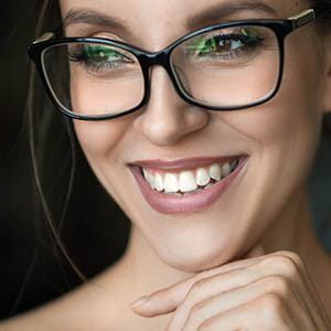 woman smiling after dental exam