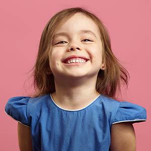 child smiling after dental exam