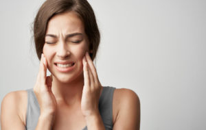 Woman struggles with the pain associated with impact