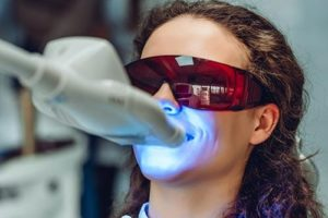 individual getting teeth whitening services
