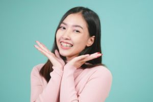 young woman after orthodontics